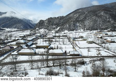 View Of The Village From The Top In The Snow. Aerial View Of Snow Covered Traditional Housing Suburb