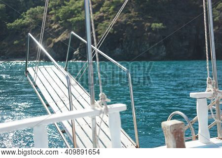 Boat With Beautiful View Of Sea And Mountains. Sea Voyage Concept.