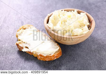 cottage cheese- bowl of cheese and slice of bread