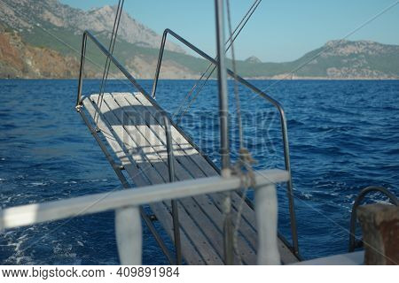 The View Of The Sea And Mountains From Sailboat. Summer Vacation And Sea Voyage Concept.