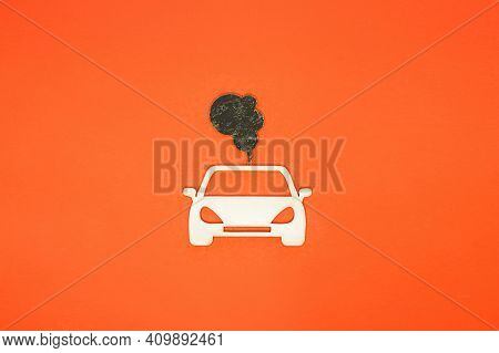 Car And Exhaust Gases On An Orange Background. Air Pollution