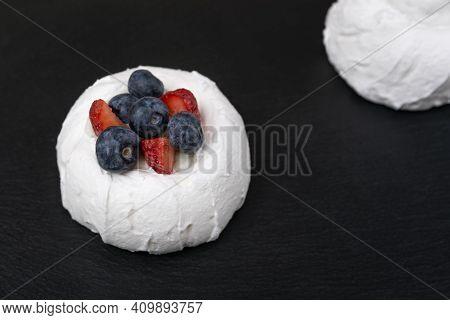 Meringue Cake With Fresh Strawberries And Blueberries. Cake Anna Pavlova. Close Up.