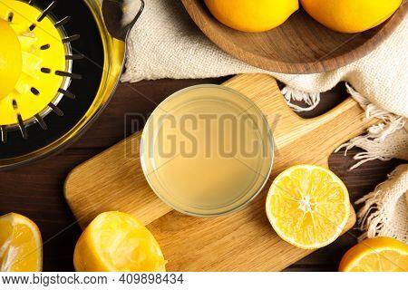 Freshly Squeezed Lemon Juice On Wooden Table, Flat Lay