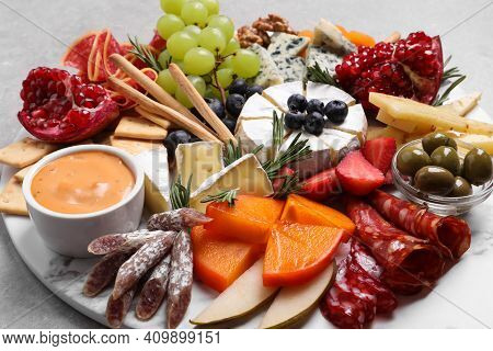Assorted Appetizers Served On Light Grey Table, Closeup