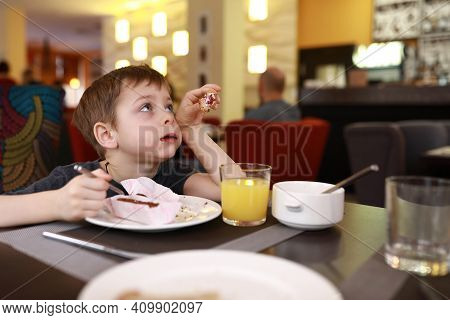 Child Has Dessert For Breakfast