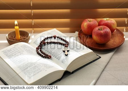 Bible With Prayer Beads, Candle And Apples Near Window Indoors. Great Lent Season