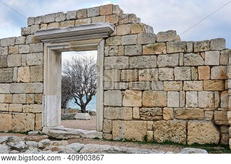 Doorway In The Wall On The Ruins Of An Antique Temple On The Seashore