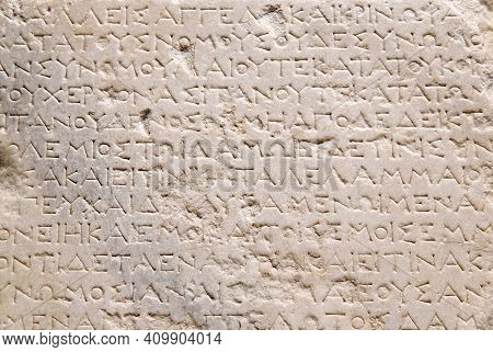 Sevastopol, Crimea - January 31, 2021: Fragment Of A Marble Slab With A Carved Text Of The Ancient G
