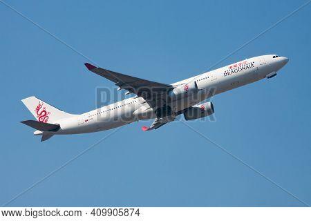 Hong Kong, China - December 1, 2013: Dragonair Airbus A330-300 B-hyq Passenger Plane Departure And T