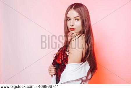 A Gorgeous Brunette In A Shiny Red Dress Is Dancing, A Model In A White Jacket Is Having Fun. Girl I