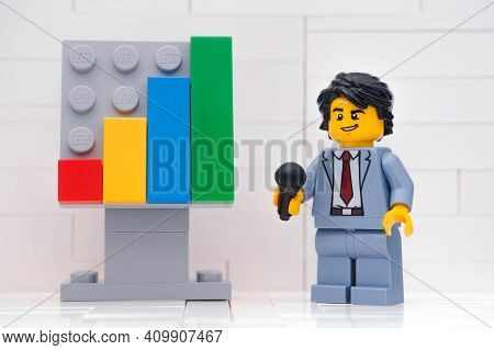 Tambov, Russian Federation - January 13, 2021 Lego Entrepreneur Minifigure Using Microphone And Disc