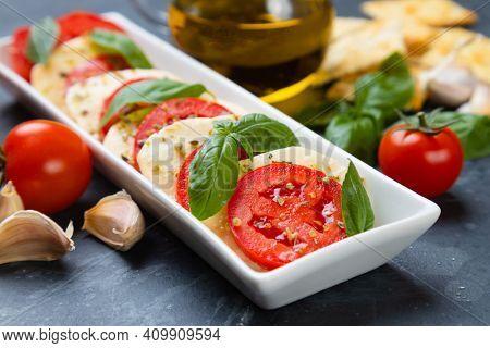 Fresh italian caprese salad with mozzarella cheese, tomato and basil