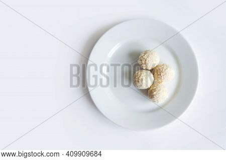 Raw Vegan Healthy Dessert, Coconut Bliss Balls On White Plate Isolated On White Background. Top View