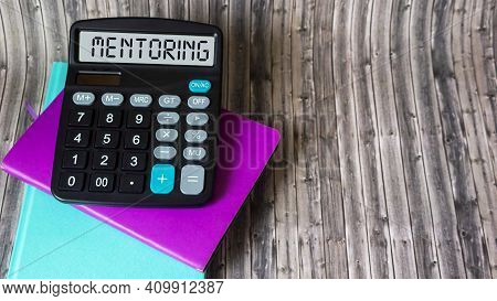 Mentoring - Word Written On Calculator Display Mentoring Concept, Help And Advice