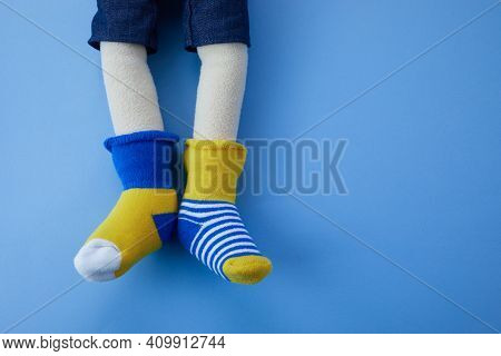 World Down Syndrome Day Background. Down Syndrome Awareness Concept. Toy Legs With Different Socks A