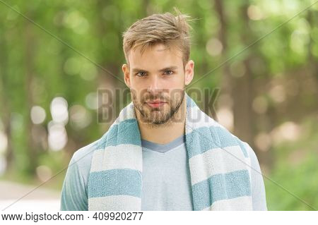 Hygiene And Health. Man With Towel On Shoulder Nature Background. Sportsman Just After Training. Spo