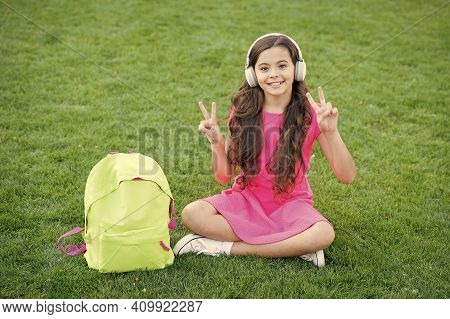Easy Listening And Study. Happy Girl Enjoy Listening To Music. Small Child Practise Listening Skills