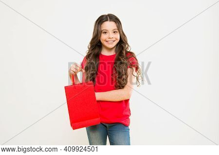 Delivery Service. Child On Yellow Background. Shopping. Child With Shopping Bag. Happy Girl With Lon