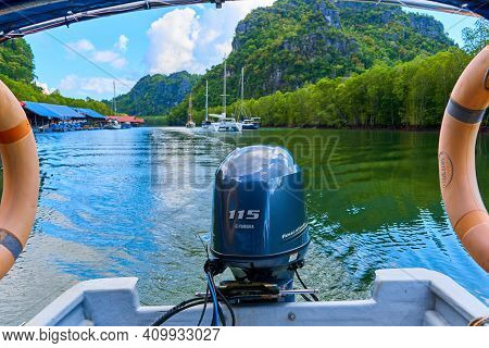 Floating On Motorboat Along River With Exciting Landscapes Of Green Rocks. Langkawi, Malaysia - 06.2