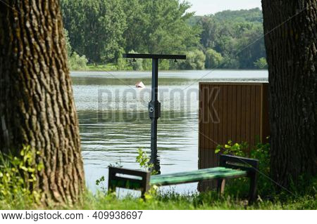 Vadul lui Voda, Criuleni, Moldova, June 2020: Flood caused by river spill after heavy rains set in Vadul lui Voda beach area. Flooded beach cabin, shower and bench