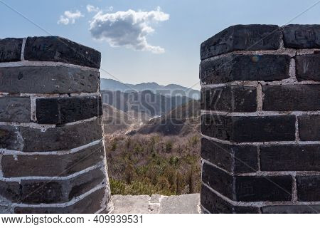 Beijing, China - April 28, 2010: Great Wall Of China. Look Through Dark Stone Battlements Upon Will