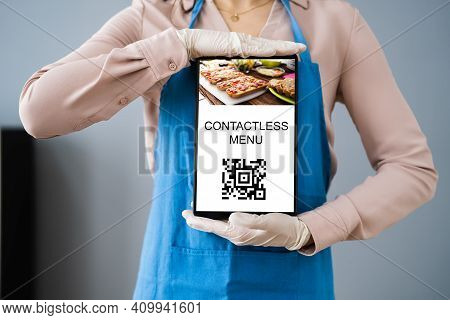 Woman In Cafe Or Restaurant Showing Contactless Menu