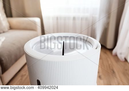 Steam From Modern Air Humidifier, Aroma Oil Diffuser At Home. Improving The Comfort Of Living In A H