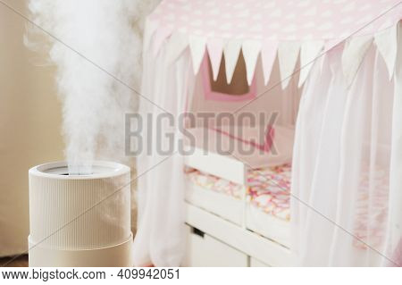 Modern Air Humidifier In Childrens Room, Aroma Oil Diffuser At Home. Improving The Comfort Of Living