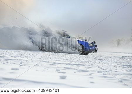 Sliding On An Ice Line. Snow Drifting. Snowy Land Road At Winter
