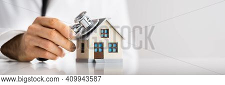 Doctor Doing Homecare Inspection. House Property Check