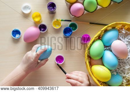 Little Child Hands Painting Colored Eggs. Easter Family Holiday Celebration At Home And Craft Concep