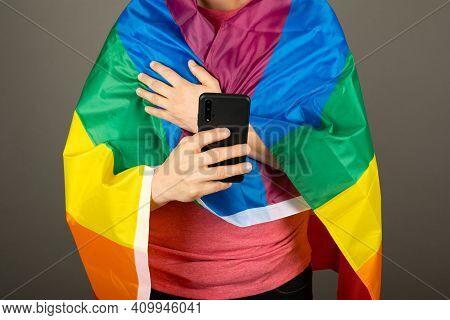 Gay Man Wearing Pink T Shirt And A Rainbow Flag