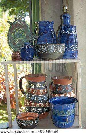 Caribbean Artisan Craft Pottery, Pitchers And Lamp.