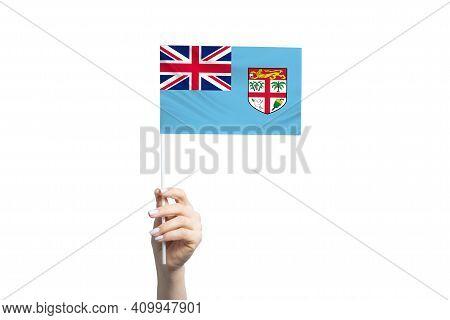 Beautiful Female Hand Holding Fiji Flag, Isolated On White Background.