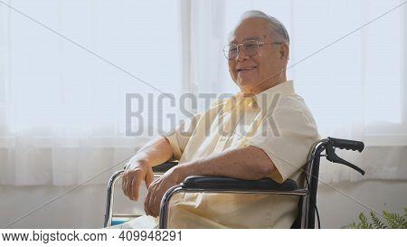 Portrait Asian Happy Face Senior Old Man Sitting In Wheelchair Smiling In Nursing Home, Closeup Disa