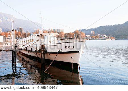 The Lake Tour Cruise Ship Docked In The Harbor, Lecco Lakefront, Como Lake District. Italian Traditi