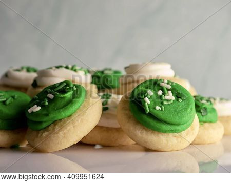 St Patrick's Day Holiday Frosted Sugar Cookies With Green And White Frosting And Sprinkles With Four