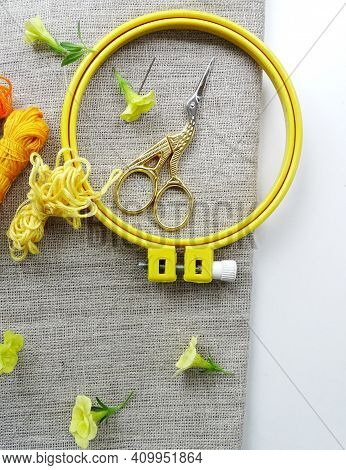 Materials For Embroidery: Scissors, Canvas, Thread And Embroidery Frame. Small Yellow Flowers
