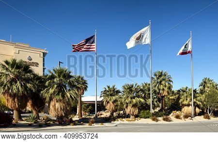 PALM SPRINGS, CA - MARCH 24, 2017: Glags line the entrance road  at the Agua Caliente Casino Resort Spa on Bob Hope Drive.