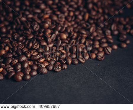 Aromatic Coffee Beans On A Dark Background Closeup Close-up