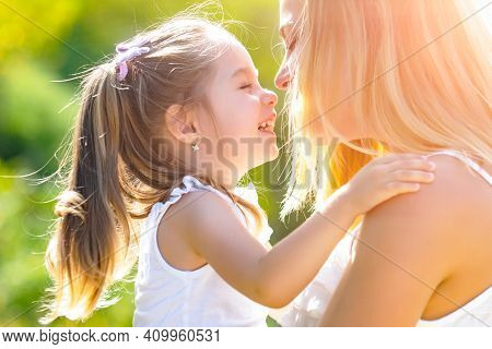Mom And Daughter Outside. Happy Loving Family Mother And Daughter In Spring
