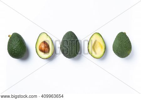 Fresh Avocados Pieces Set Isolated On White Background. Top View.