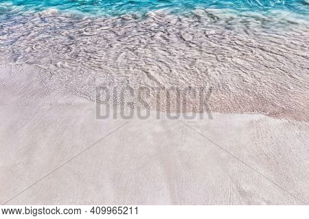 Sea Surf On The Beach With Coral Sand In The Tropics.