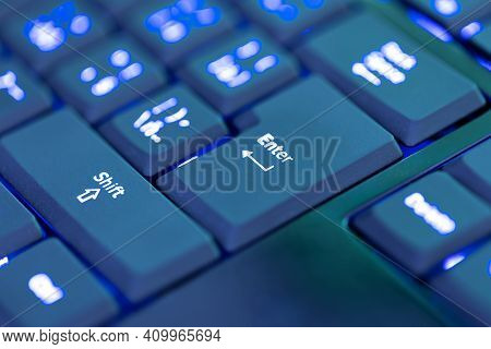 Closeup Of Laptop Or Desktop Computer Keyboard Illumination, Blue Backlit Keyboard. Focus To Key Ent