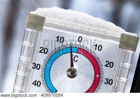 Closeup Photo Of An Outdoor Window Thermometer Covering With Snow With Negative Temperature In Degre