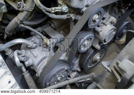 Detail Of The Engine  Fragment Include Ac Compressor Generator Belt And Pulley.