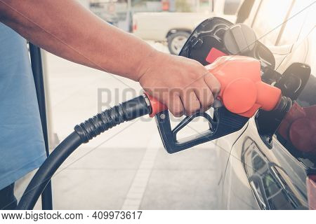 Car Refueling On Petrol Station. To Fill The Machine With Fuel. Car Refueling With Gasoline At Gas S