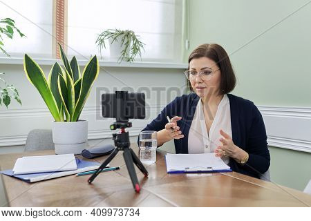 Psychology, Mental Help Online. Mature Woman Psychologist, Professional Counselor Giving Video Consu
