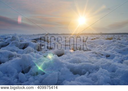 Ice Floe In Arctic With Sun Rays Over Frozen Water