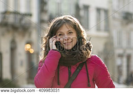 Close-up Of A Street Portrait Of A Cheerful, Successful Middle-aged Woman With Delicate Features Tal